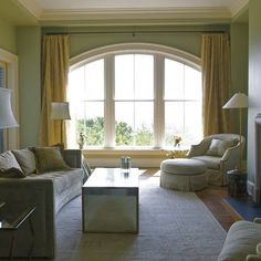 Arch Window Treatment Design, put rod high, next to the ceiling with floor length drapes.