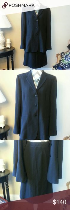 """Armani Collezioni Black Suit - Made in Italy Armani Collezioni black virgin wool - rayon blend suit. 3 button single breast blazer with 2 faux pockets.  Skirt has zipper and button closure. Skirt measures 19"""" at waist when laid flat. Skirt is 26"""" long with slit in the back. 100% rayon lining in both pieces. Armani Collezioni Jackets & Coats Blazers"""