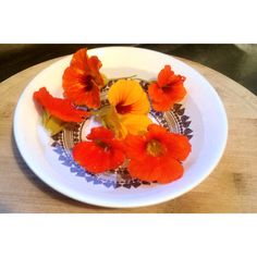 Edible blooms make for a beautiful garnish - nasturtiums add a peppery bite to any meal