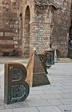 Barcelona letters, at the Roman wall of Barcelona, next to the Cathedral. Barcelona, Catalonia.