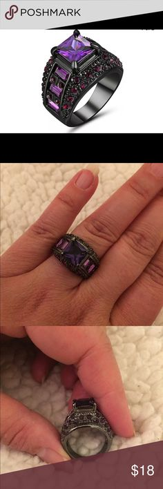Amethyst & Black Gold Ring New, never worn. No box, it came in a plastic baggie. 5.90 ct. AAA clear lab created stone. Black gold filled. Multiple smaller stones, appears to be two shades of purple. Size 8. Gorgeous ring! The black metal and purple stones are really stunning. Jewelry Rings