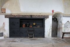 Period kitchen with vaulted ceiling, stone floor and delapadated charm