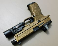 My Smith and Wesson M&P 9mm. Cerakoted in Burnt Bronze.