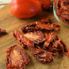 Sun dried tomatoes are easy to make in a dehydrator. Learn how to make your own homemade sun dried tomatoes and save on the family budget. Canning Whole Tomatoes, Dried Tomatoes, Plum Varieties, Making Homemade Pizza, Thing 1, Sliced Tomato, How To Make Pizza, Dehydrator Recipes, Love Eat
