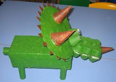 A colourful Triceratops model made from an egg box and a shoe box - a great dinosaur craft idea.