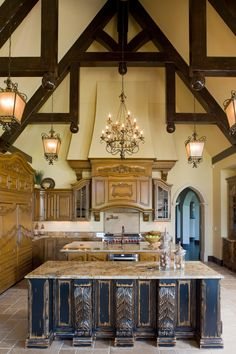 I have one of those light fixtures in my entry. I can only image how big this kitchen is with 4!