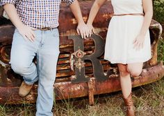 Rustic Fall Engagement Picture up against a tree instead of truck