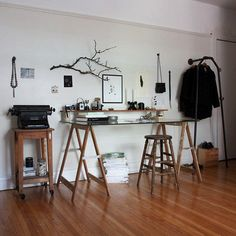 perfect, clean, industrial desk of sawhorses with glass workspace