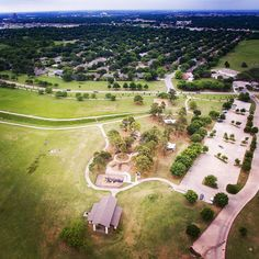 North Lakes Park. Rows of trees in the back are a well-established neighborhood with a large tree in every yard. #denton #dronepointofview #park #drone