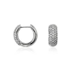 Highlight any and every look with these opulent hoop earrings, showcasing pavé-set round diamonds framed in dazzling 14k white gold.