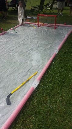 Slip N Slide hockey rink. Fun noodles construction grade plastic drop cloth. Hose water, dish soap,  street sticks and pucks means HOURS of summer fun!