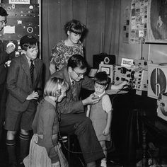 An amateur radio station at the Festival of Britain exhibition attracts young visitors