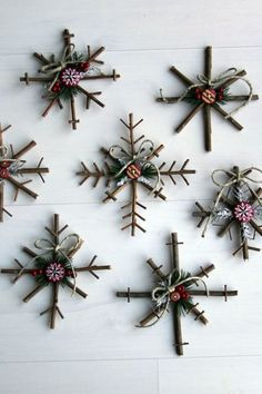 These charming crafts are made with twigs and decorated with button stickers, pine needles, berries, twine, and felt. They can even be used for festive wall art this holiday season.