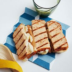 Grilled cheese for breakfast? When you stuff oatmeal bread with almond butter, banana, and cream cheese, why not?!