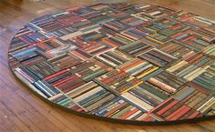 Book rug! Recycled books spines make a fun and interesting rug, perfect for a bibliophile!