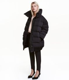 Black. PREMIUM QUALITY. Oversized down jacket in woven fabric. Detachable stand-up collar with snap fasteners, zip and wind flap at front with snap