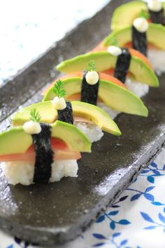 Vegan Avocado and Tomato Nigiri Sushi... just use vegan mayo. I'm probably going to try it with brown rice too, since its better for you!