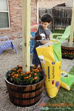 Add a DIY Patio Area with fun planter posts to a backyard area.
