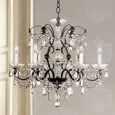 A beautifully detailed crystal chandelier designed exclusively for us by Schonbek.