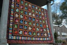Amish quilt in Lancaster County, PA. I love driving through Lancaster as you see so many beautiful quilts on porches and clotheslines like this one. Some are for sale, some are just drying in the sun. #quilt #amish