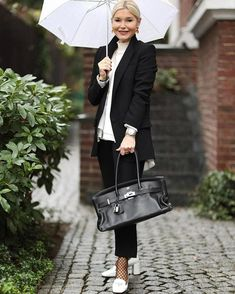 how to dress after 40 - Petra wears a black suit and white shoes | 40plusstyle.com