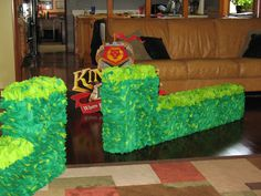 """Fun way to add some greenery to your Kingdom Rock set.   Tape soda boxes together and a 14""""X 22"""" box on the ends for a little height.  - Covered the colored soda boxes with brown craft paper and used Elmer's glue for adhesive.  - cover with green tissue paper"""