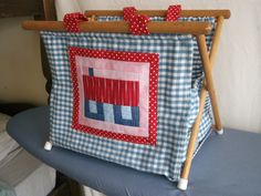 Made by Maria Cross.  I Re-covered knitting basket from two old house blocks I had. A wee bit Cath Kidston style.