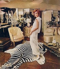John Moore, once a designer for Marilyn Monroe, was devoted to the cool glitter of crystal. Moore's Apartment (above) is lined with mirrors, a zebra rug and a black and white glass screen painting of a jazz band. Men Design, Classic Chic, Chic Dress, Zebra Print, New York Fashion, Decoration, 1960s, Vintage Fashion, Glamour