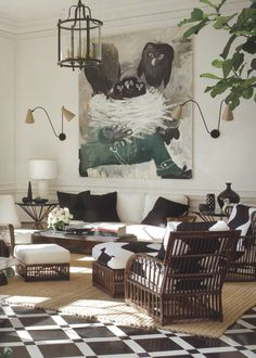 Wicker at its best. Hot floors, great sconces and the art is a hoot!