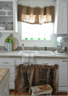 I love the clothes-pinned burlap curtain! Freakin cute idea! :D