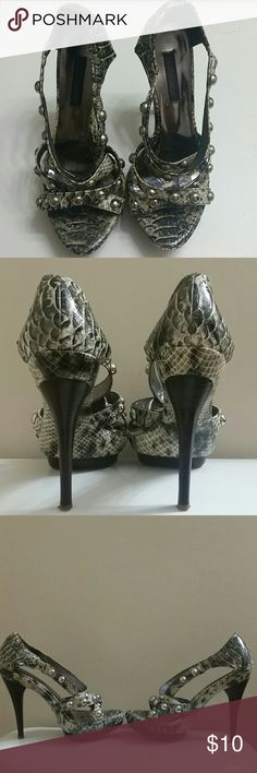 Selling this Snake skin print, bold studded heels on Poshmark! My username is: khadijamichelle. #shopmycloset #poshmark #fashion #shopping #style #forsale #Dollhouse #Shoes