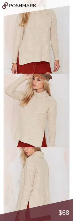 Neuw Splits Knit Turtleneck Sweater This knit's basic in the best possible way (yeah, we said it). The Splits Sweater by Neuw is made in a chunky beige knit and features a turtleneck and slits at sides. Pair it with skinnies, ankle boots, and a suede backpack.  *Cotton/Nylon/Wool  *Runs true to size  *Model is wearing size x-small  *Hand wash cold  *Imported Sweaters