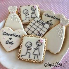 Sugar Cookies with Royal Icing for an Engagement  These are still one of my favorite sets, and most popular. The calendar with wedding date circled, the stick figure engagement couple, wedding gowns,