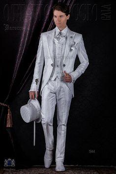 Baroque white brocade frock coat with peak lapels and crystal rhinestones and crystal brooch. Wedding suit 1944 Baroque Collection Ottavio Nuccio Gala.
