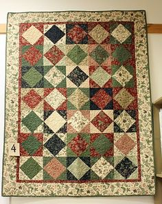 Throw-size quilt made from Kansas Troubles fabrics by Moda