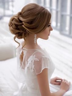 So feminine and lovely. I love it when women and girl's can dress up like this - note the posture - Shoulders back, back straight, head high, relaxed hands...The Chandelier Earrings with the swept back bun a very classy.