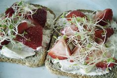 Ingredients For A Delicious New York Breakfast = toast, cream cheese, sliced strawberries and alfalfa sprouts.