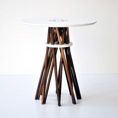 What a lovely table! The legs melted into the table top surface are especially great. Bundle Side Table Walnut