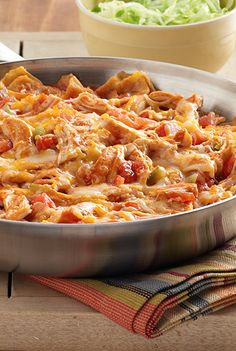 The flavor of an enchilada recipe made quickly in a skillet with torn corn tortillas, cooked chicken, zesty tomatoes and sauce with cheese