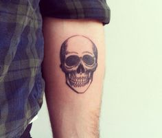 skull tattoo via Tattoologist