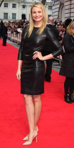 Cameron Diaz looks stunning in a skintight black leather dress.