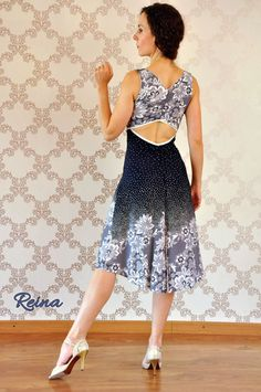 Beautiful summer dress dark blue with white polka dots and flowers. Very thin and soft elastic fabric. Ideal for dancing tango as it has a slit on the back. Size M only