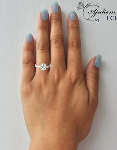 1.00 carat diamond: View diamond sizes on hand, finger and ring in full size. Find the right size for your engagement ring To match and adjust click on the images of the hand icons..  http://www.ajediam.com/diamond_sizes_on_hand_finger_ring.html