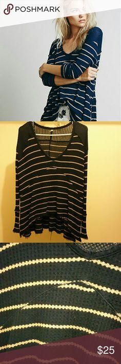 Free People Sunset Park Thermal Free People Sunset Park thermal top in the cutest color color combo-navy/tan stripe. The hem is a little ragged from being washed as pictured. Other than that in great condition! Free People Tops Tees - Long Sleeve