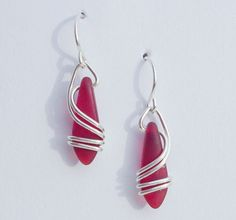 Classic RED Earrings ~ Right Coast I use 20 gauge, sterling silver wire ~ which gracefully flows down & around the matte, RED glass. This is NOT beachglass, rather they are pressed beads from the czech republic. The glass does, however, look very much like beachglass They