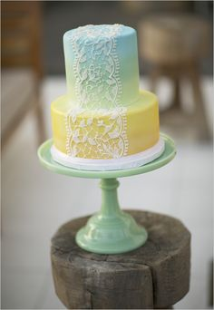 Blue, green, yellow ombre with a lace overlay on a jadeite stand