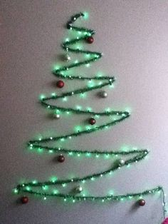 35 Gorgeous Tinsel Wall Christmas Tree Design Ideas - Millions of people display Christmas trees in their homes each year, and many of those trees feature the same decorations, year after year: round glas. Wall Christmas Tree, Creative Christmas Trees, Christmas Tree Design, Noel Christmas, Office Christmas, Simple Christmas, Outdoor Christmas, Christmas Lights, Xmas Trees