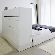 Turned bed with built-in storage in headboard I Remodelista Small Space Design, Small Space Living, Small Rooms, Small Apartments, Small Spaces, Bedroom Storage, Storage Headboard, Bed Storage, Hidden Storage