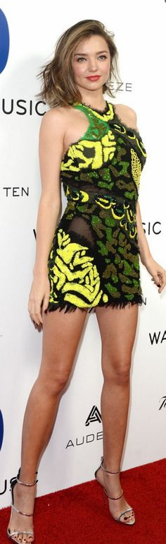 Who made  Miranda Kerr's green print dress and silver sandals?