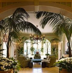 Green and cream trellised garden room in an absolutely enormous Georgian revival style pile in Dallas, TX by Robert A.M. Stern.